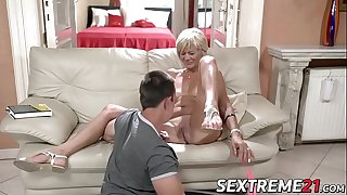 Horny granny enjoys riding and sucking thick young dick